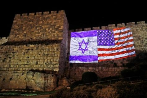 American and Israeli Flags on Jerusalem walls